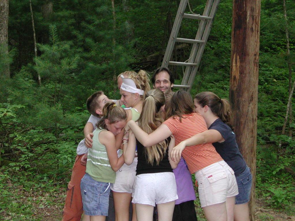pole-climbing-group-hug
